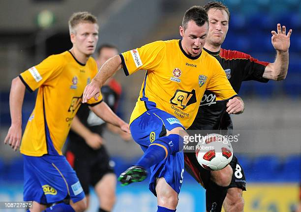 Shane Smeltz of Gold Coast strikes at the ball during the round 25 A-League match between Gold Coast United and Adelaide United at Skilled Park on...