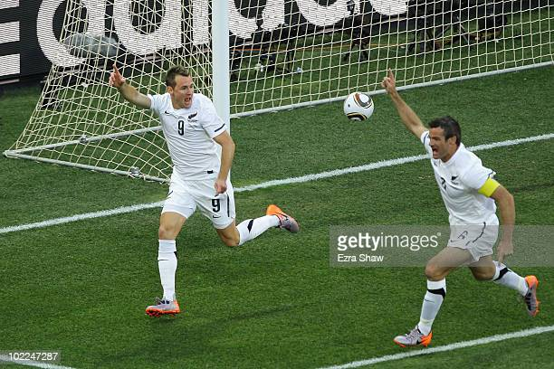 Shane Smeltz of New Zealand celebrates scoring the opening goal with captain Ryan Nelsen during the 2010 FIFA World Cup South Africa Group F match...