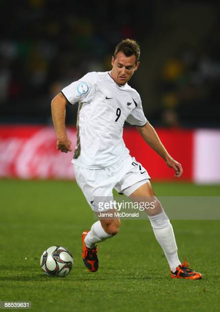 Shane Smeltz of New Zealand runs with the ball during the FIFA Confederations Cup match between South Africa and New Zealand at Royal Bafokeng...