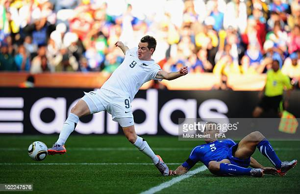 Shane Smeltz of New Zealand scores the opening goal while Fabio Cannavaro of Italy can just nlook on during the 2010 FIFA World Cup South Africa...