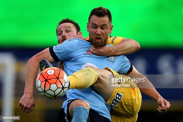 Shane Smeltz of Sydney FC contests the ball against Joshua Rose of the Mariners during the round four A-League match between the Central Coast...