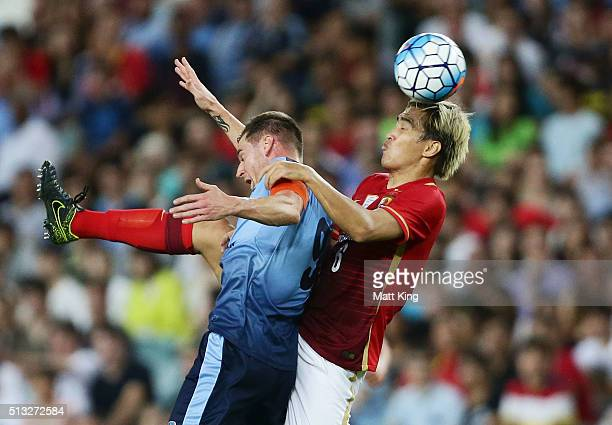 Shane Smeltz of Sydney FC is challenged by Feng Xiaoting of Guangzhou Evergrande during the AFC Champions League match between Sydney FC and...