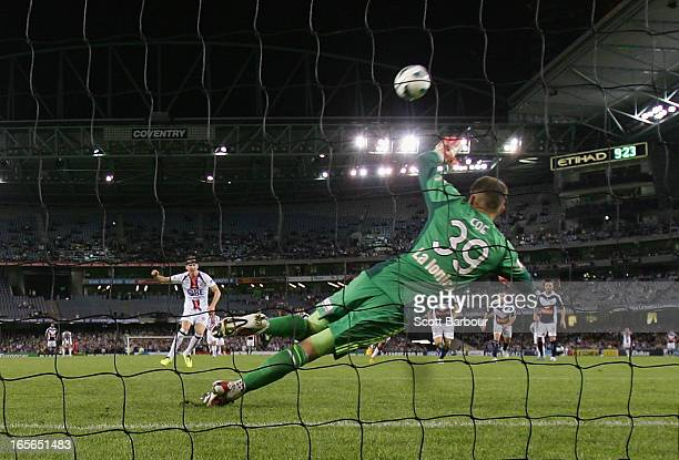 Shane Smeltz of the Glory misses a shot at goal from the penalty spot as Victory goalkeeper Nathan Coe dives during the ALeague Elimination final...