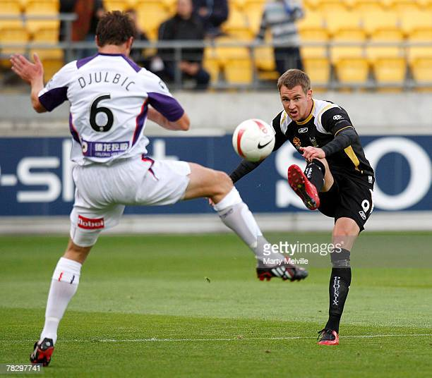 Shane Smeltz of the Phoenix gets a kick away past Dino Djulbic of the Glory during the round 16 A-League match between the Wellington Phoenix and the...