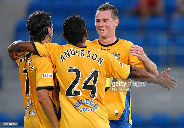 Shane Smeltz of United celebrates a United goal with team mates Anderson Alves Da Silva and Zenon Caravella during the round 21 ALeague match between...