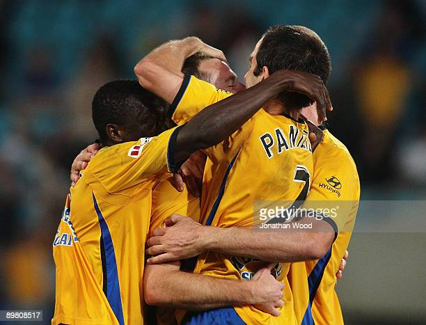 Shane Smeltz of United celebrates with team mates after scoring a goal during the round two ALeague match between Gold Coast United and North...