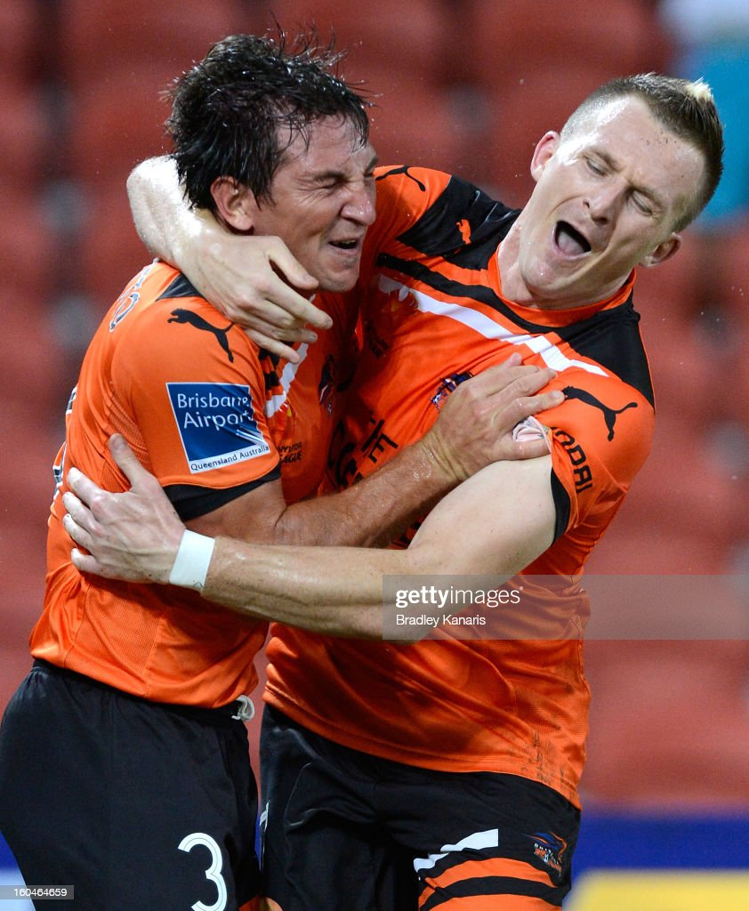 Shane Stefanutto (L) and Besart Berisha of the Roar celebrate after a goal during the round 19 A-League match between the Brisbane Roar and the Central Coast Mariners at Suncorp Stadium on February 1, 2013 in Brisbane, Australia.
