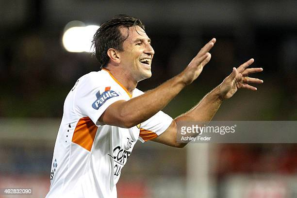 Shane Stefanutto of the Roar celebrates a goal with team mates during the round 16 A-League match between the Newcastle Jets and Brisbane Roar at...