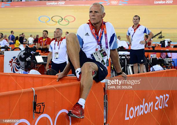 Shane Sutton coach of Britain's Edward Clancy observes his race in the London 2012 Olympic Games men's omnium 1km time trial cycling event at the...