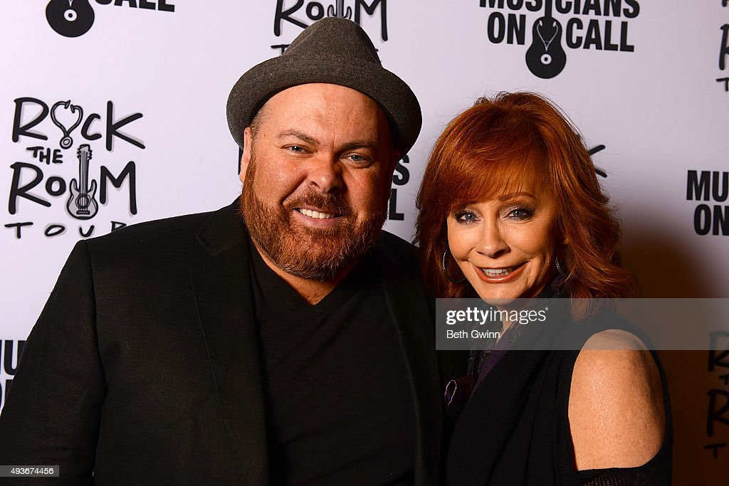 Shane Tarleton, and Reba McEntire on the red carpet before the Musicians on Call event at City Winery Nashville on October 21, 2015 in Nashville, Tennessee.