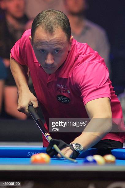 Shane Van Boening of USA plays a shot against Chris Melling of UK during the semifinal of 2014 Partypoker World Pool Masters on November 16 2014 in...