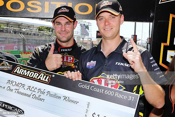 Shane van Gisbergen and Jonathon Webb drivers of the TEKNO VIP Petfoods Holden celebrate after taking pole position during the top 10 shootout for...