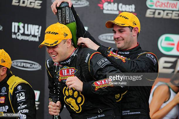 Shane van Gisbergen and Jonathon Webb drivers of the TEKNO VIP Petfoods Holden celebrate after winning race 31 for the Gold Coast 600 which is round...