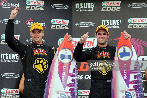 Shane van Gisbergen and Jonathon Webb drivers of the TEKNO VIP Petfoods Holden celebrates after winning race 31 for the Gold Coast 600 which is round...