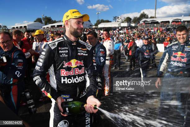 Shane Van Gisbergen driver of the Red Bull Holden Racing Team Holden Commodore ZB celebrates after winning race 20 of the Supercars Ipswich...