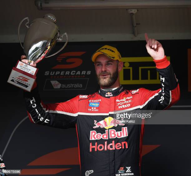 Shane Van Gisbergen driver of the Red Bull Holden Racing Team Holden Commodore VF celebrates after winning race 23 for the Auckland SuperSprint which...