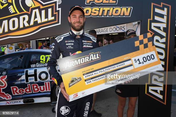 Shane Van Gisbergen driver of the Red Bull Holden Racing Team Holden Commodore ZB celebrates after taking pole position for race 1 during the top 10...