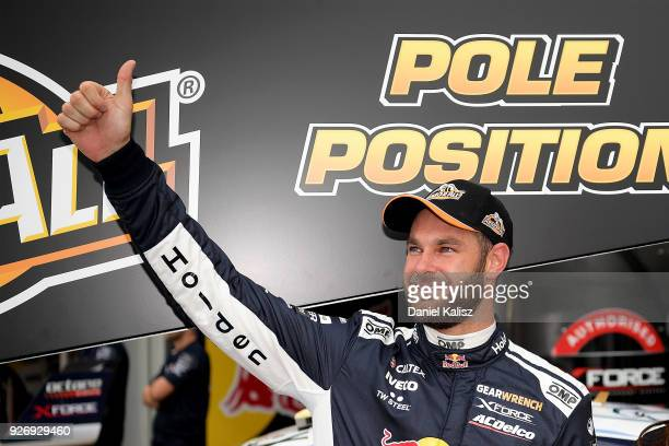 Shane Van Gisbergen driver of the Red Bull Holden Racing Team Holden Commodore ZB celebrates after taking pole position during the top ten shootout...