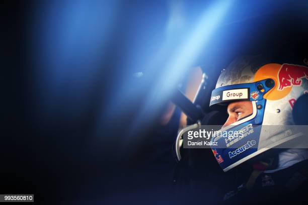 Shane Van Gisbergen driver of the Red Bull Holden Racing Team Holden Commodore ZB looks on during the top ten shoot out for race 18 of the Supercars...