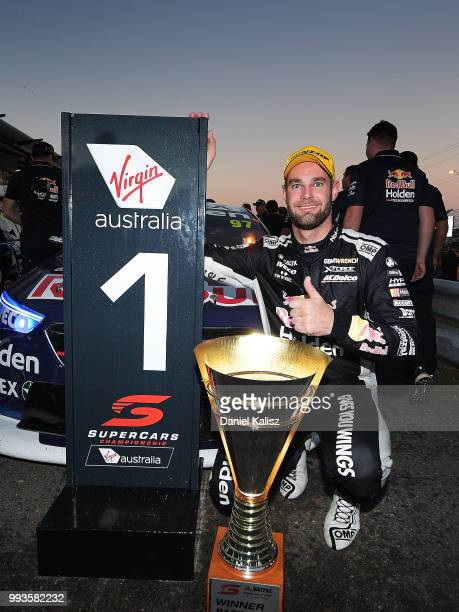 Shane Van Gisbergen driver of the Red Bull Holden Racing Team Holden Commodore ZB celebrates after winning race 18 of the Supercars Townsville 400 on...