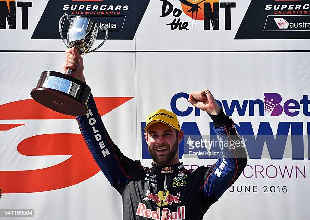 Shane Van Gisbergen driver of the Red Bull Racing Australia Holden Commodore VF celebrates on the podium after winning race 2 for the V8 Supercars...