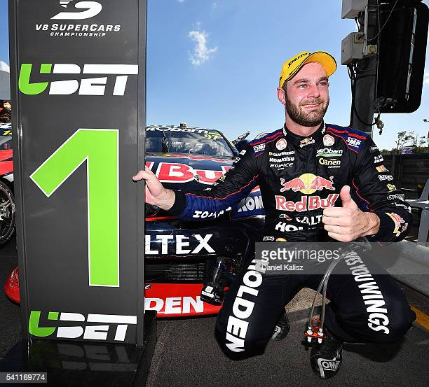 Shane Van Gisbergen driver of the Red Bull Racing Australia Holden Commodore VF celebrates after winning race 2 for the V8 Supercars Darwin Triple...