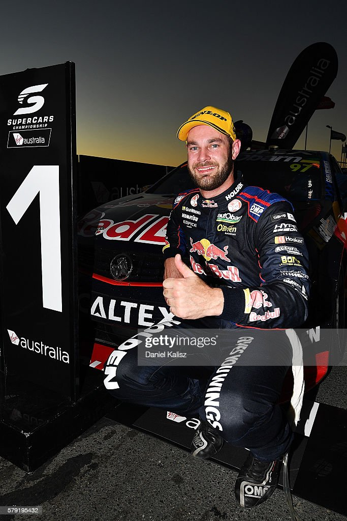 Shane Van Gisbergen driver of the #97 Red Bull Racing Australia Holden Commodore VF celebrates in parc ferme after winning race 1 for the V8 Supercars Ipswich Supersprint on July 23, 2016 in Ipswich, Australia.