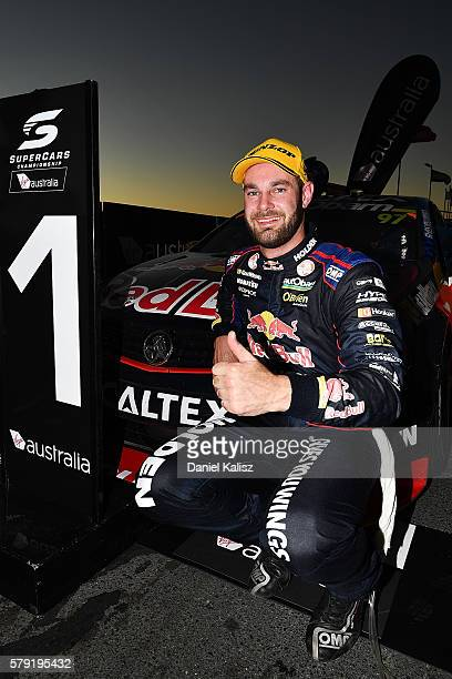 Shane Van Gisbergen driver of the Red Bull Racing Australia Holden Commodore VF celebrates in parc ferme after winning race 1 for the V8 Supercars...