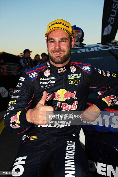 Shane Van Gisbergen driver of the Red Bull Racing Australia Holden Commodore VF celebrates after winning race 1 for the V8 Supercars Sydney...