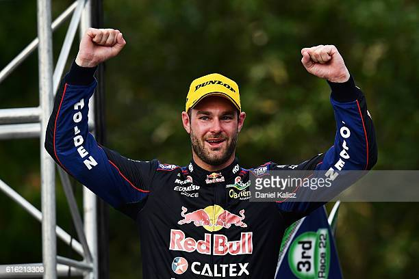 Shane Van Gisbergen driver of the Red Bull Racing Australia Holden Commodore VF reacts on the podium after finishing first during race 22 of the...