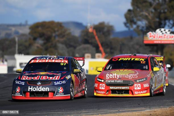 Shane Van Gisbergen drives the Red Bull Holden Racing Team Holden Commodore VF leads Fabian Coulthard drives the Shell VPower Racing Team Ford Falcon...