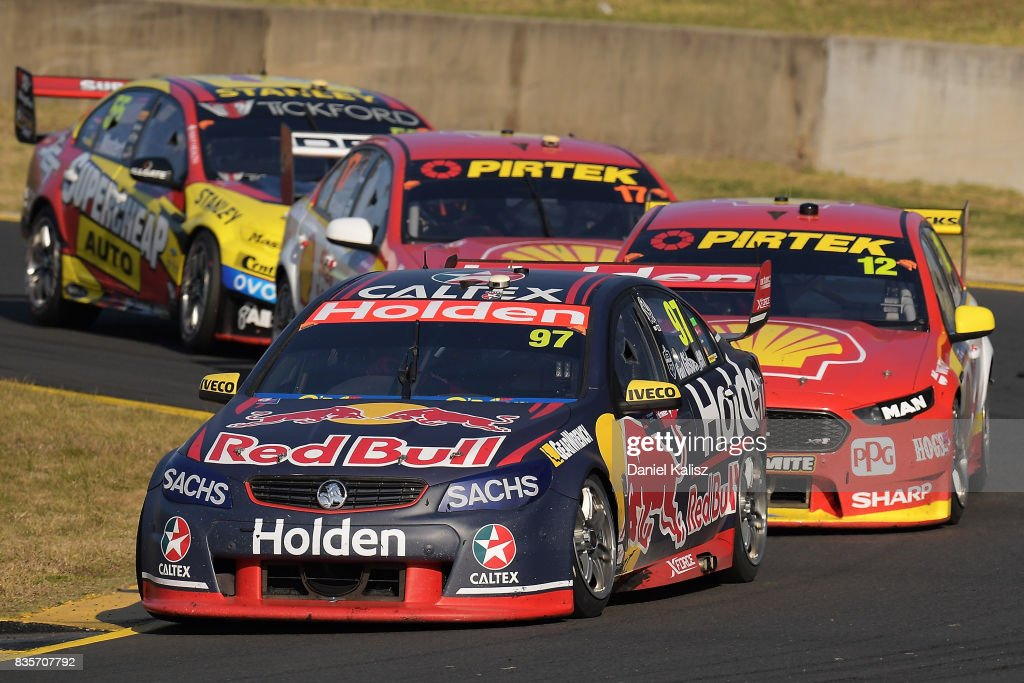 Shane Van Gisbergen drives the #97 Red Bull Holden Racing Team Holden Commodore VF leads Fabian Coulthard drives the #12 Shell V-Power Racing Team Ford Falcon FGX during race 18 for the Sydney SuperSprint, which is part of the Supercars Championship at Sydney Motorsport Park on August 20, 2017 in Sydney, Australia.