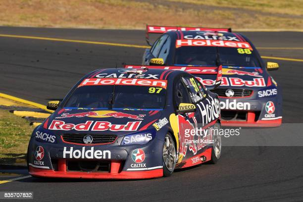 Shane Van Gisbergen drives the Red Bull Holden Racing Team Holden Commodore VF leads Jamie Whincup drives the Red Bull Holden Racing Team Holden...