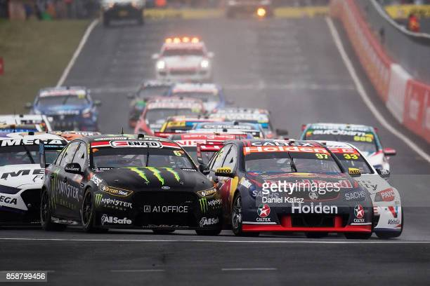 Shane Van Gisbergen drives the Red Bull Holden Racing Team Holden Commodore VF and Cameron Waters drives the Monster Energy Ford Falcon FGX battle...