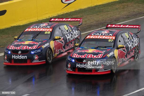 Shane Van Gisbergen drives the Red Bull Holden Racing Team Holden Commodore VF and Jamie Whincup drives the Red Bull Holden Racing Team Holden...