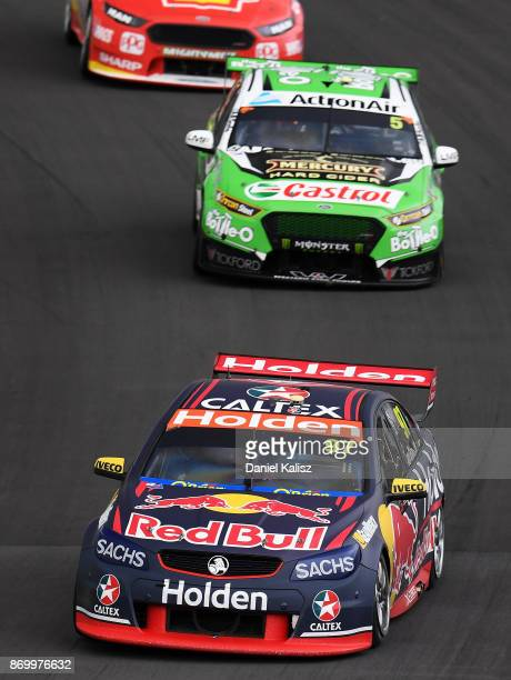 Shane Van Gisbergen drives the Red Bull Holden Racing Team Holden Commodore VF leads Mark Winterbottom drives the The BottleO Racing Ford Falcon FGX...