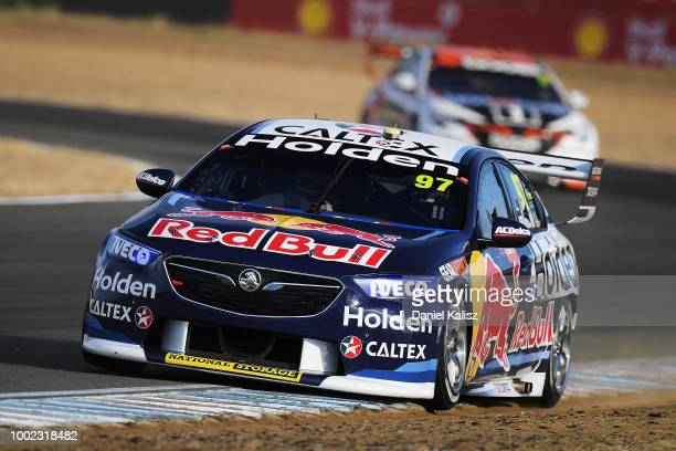 2nd place Shane Van Gisbergen driver of the Red Bull Holden Racing Team Holden Commodore ZB congratulates race winner Scott McLaughlin driver of the...