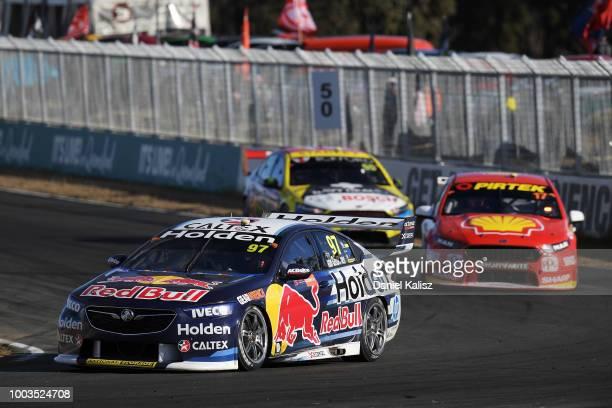 Shane Van Gisbergen drives the Red Bull Holden Racing Team Holden Commodore ZB leads Scott McLaughlin drives the Shell VPower Racing Team Ford Falcon...