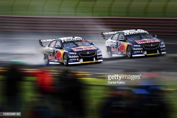 Shane Van Gisbergen drives the Red Bull Holden Racing Team Holden Commodore ZB is passed by Jamie Whincup drives the Red Bull Holden Racing Team...