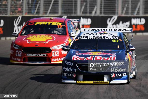 Shane Van Gisbergen drives the Red Bull Holden Racing Team Holden Commodore ZB leads Scott McLaughlin drives the Shell VPower Racing Team Ford Falcon...