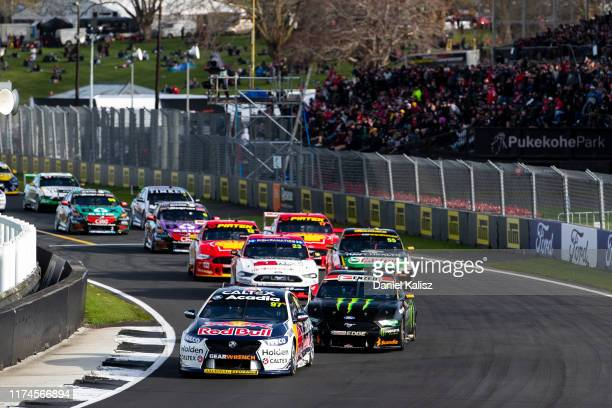 Shane van Gisbergen drives the Red Bull Holden Racing Team Holden Commodore ZB leads Cameron Waters drives the Monster Energy Racing Ford Mustang...