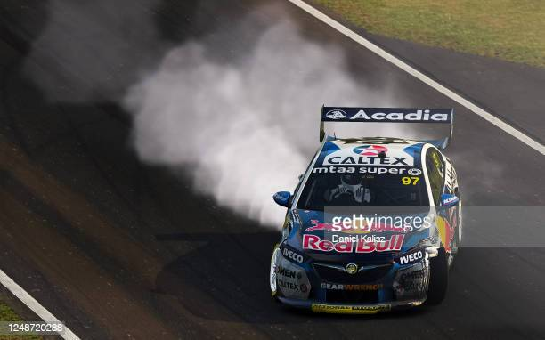 Shane van Gisbergen drives the Red Bull Holden Racing Team Holden Commodore ZB celebrates after winning the Championship during round 10 of the...