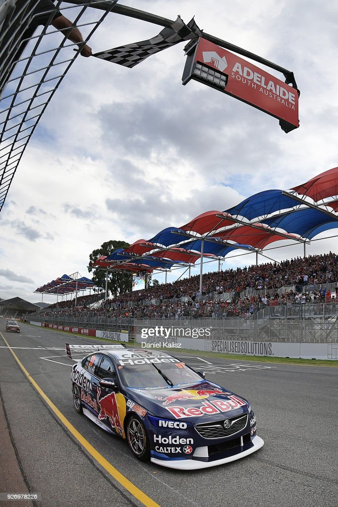 Shane Van Gisbergen drives the #97 Red Bull Holden Racing Team Holden Commodore ZB crosses the finish line to win race 2 for the Supercars Adelaide 500 on March 2, 2018 in Adelaide, Australia.