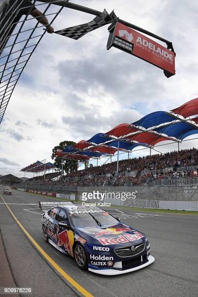 Shane Van Gisbergen drives the Red Bull Holden Racing Team Holden Commodore ZB crosses the finish line to win race 2 for the Supercars Adelaide 500...