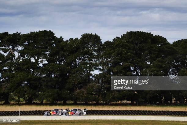 Shane Van Gisbergen drives the Red Bull Holden Racing Team Holden Commodore ZB passes Jamie Whincup drives the Red Bull Holden Racing Team Holden...