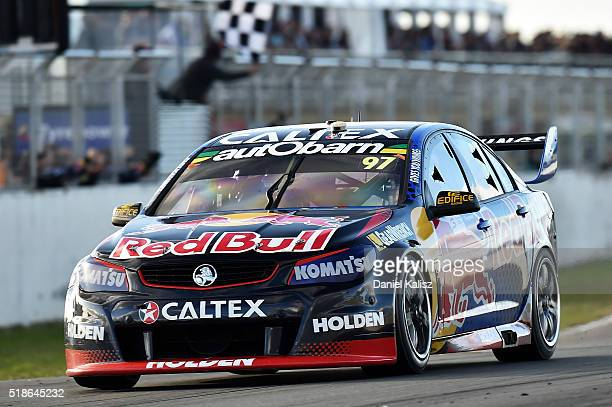 Shane Van Gisbergen drives the Red Bull Racing Australia Holden Commodore VF takes the chequred flag to win Race 1 of the V8 Supercars Tasmania...