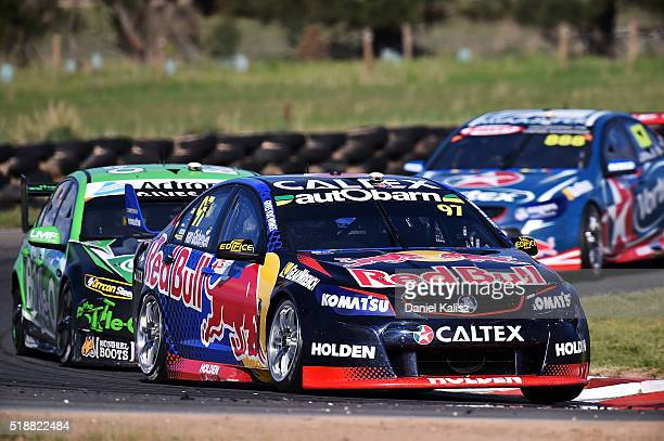Shane Van Gisbergen drives the Red Bull Racing Australia Holden Commodore VF during race 2 for the V8 Supercars Tasmania SuperSprint at Symmons...