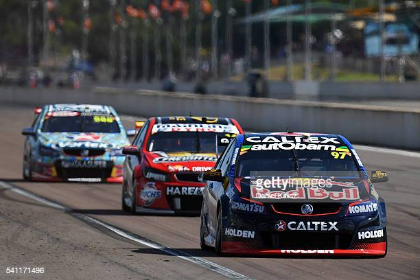 Shane Van Gisbergen drives the Red Bull Racing Australia Holden Commodore VF leads Tim Slade drives the Freightliner Racing Holden Commodore VF...