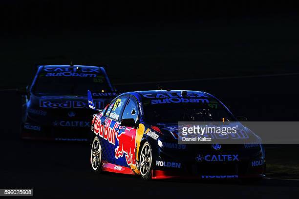 Shane Van Gisbergen drives the Red Bull Racing Australia Holden Commodore VF leads Jamie Whincup drives the Red Bull Racing Australia Holden...