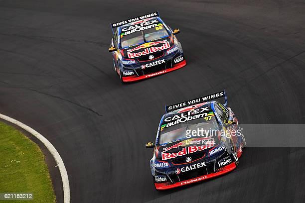 Shane Van Gisbergen drives the Red Bull Racing Australia Holden Commodore VF leads Jamie Whincup drives the Red Bull Racing Australia Holden...